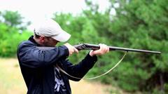 The hunter took aim and rotates around himself Stock Footage