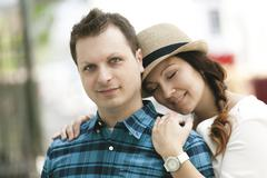 Young couple in the old part of town - stock photo