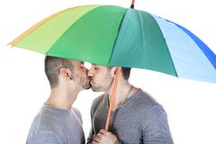A homosexual couple over a white background - stock photo
