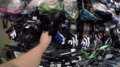 Rack with accessories, clothing and equipment for for cycling in chain store Stock Footage