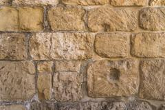 Old crag Stone wall texture or background - stock photo