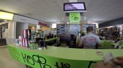 Buying a cup of coffee inside shopping mall FM, Simferopol, Crimea Stock Footage