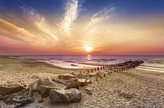 Magical sunset over Baltic Sea coast, Miedzyzdroje in Poland. - stock photo