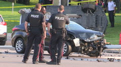 Police at scene of fatal car accident with one person killed at scene Stock Footage