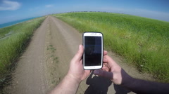 Man use sports tracker app on smart phone to track workout results Arkistovideo