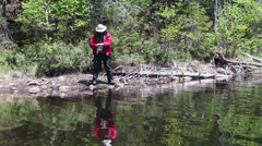 Fisherman and his reflection Stock Footage