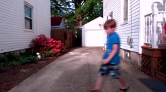 Four kids hug one another in their drive way then run off in opposite directions - stock footage