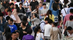 Crowd Chinese people walking at street:slow motion - stock footage
