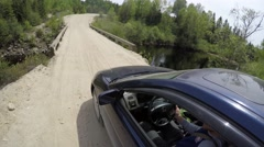 4k driver films self going over neat bridge Stock Footage