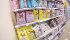 Choosing the litter box filler for cat at pet store Stock Footage