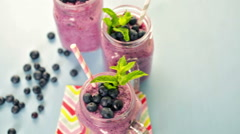 Blueberrie smoothie made with fresh organic blueberries and plain yogurt. Stock Footage