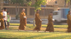 Monks near the Royal Palace complex in Phnom Penh, Cambodia Stock Footage