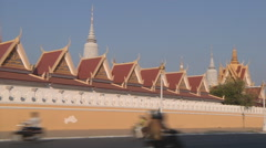 Street and the Royal Palace complex at Phnom Penh, Cambodia Stock Footage