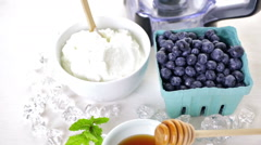 Ingredients to make smoothie with plain yogurt and fresh berries on the table. Stock Footage