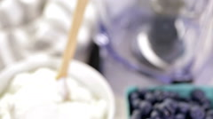 Ingredients to make smoothie with plain yogurt and fresh berries on the table. - stock footage