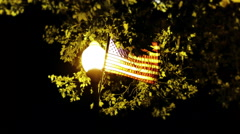 Street Lamp Post and American Flag at Night 4K Stock Footage
