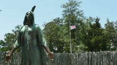 Stock Video Footage of 3786 Pocahontas Statue and English Flag Flying in Historic Jamestown Virginia