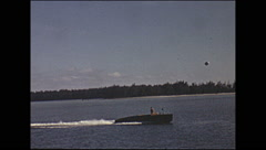 Vintage 16mm film, Miami 1946, cruising the water goodyear blimp Stock Footage