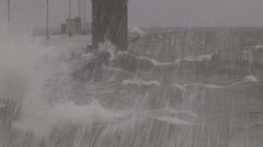Waves crashing ashore and seas rolling ahead of storm - stock footage