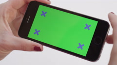 Girl hands using chroma key smartphone watching a video Stock Footage