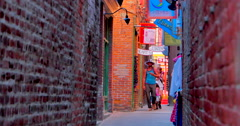 4K Family in Fan Tan Alley and store front shops, Chinatown Victoria BC Stock Footage