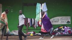 Woman knitting clothes on street, poor Africa town, Maralal, Samburu, Kenya Stock Footage
