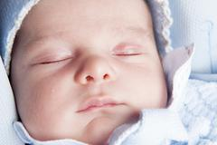 Close up of a New born face - stock photo