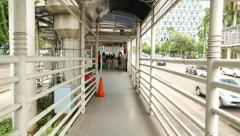Transjakarta busway shelter entrance, approach by overpass ramp Stock Footage