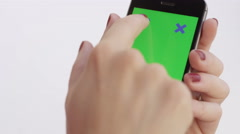 Female hands using chroma key smartphone swipe gestures - vertical portrait Stock Footage