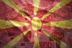 Stock Photo of colorful waving  macedonian flag on a euro money background