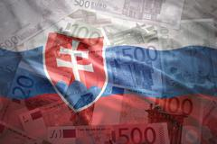 colorful waving slovak flag on a euro money background - stock photo