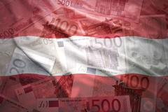 Stock Photo of colorful waving austrian flag on a euro money background