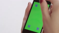 Female hands using chroma key smartphone various gestures - vertical portrait Stock Footage