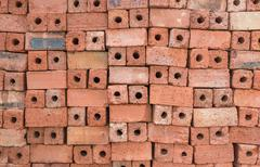 Red clay bricks for construction - stock photo
