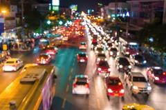 Abstact blur bokeh of Evening traffic jam on road in city Stock Photos