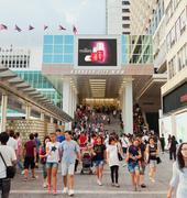 Shoppers outside Harbour City, a shopping mall in Hong Kong - stock photo