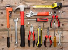 mechanical kit in wooden background. construction tool - stock photo