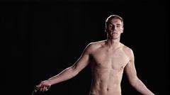 Shirtless man jumping rope Stock Footage