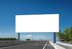 Blank White Blank board or billboard or roadsign in the street - stock photo