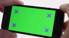 Male hands using chroma key smartphone watching a video Stock Footage