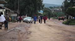 Crowd of men on poor street town of Maralal, Samburu, Kenya, establishing shot Stock Footage