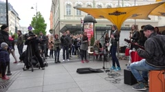 Band with girl vocalist play rock music and sing in public. 4K Stock Footage