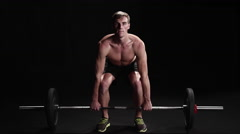 Shirtless man performing a power clean Stock Footage