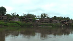 Houses on the river bank. Village in Popua, New Guinea Stock Footage