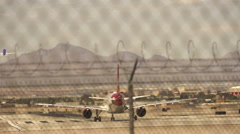 One Aircraft is starting while Rouge Airline is preparing for take off Stock Footage