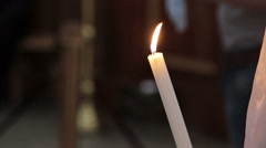 Woman holding candle in church Stock Footage