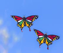 Stock Photo of Colorful Kites Flying in Blue Sky