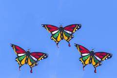 Colorful Kite Flying in Blue Sky - stock photo