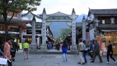 Tourists taking photos in front of foreigners street in Dali old town Stock Footage