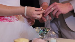 Sand ceremony being performed at wedding. Hands of bride holding vase with Stock Footage